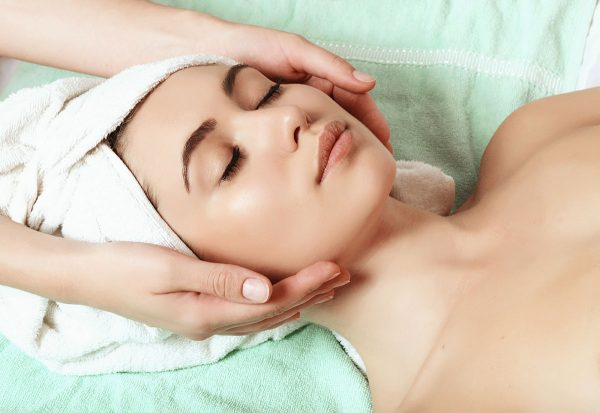 beautiful and young girl doing anti-aging facial massage