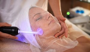 Face Skin Care. Facial Hydro Microdermabrasion Peeling Treatment High frequency